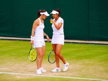 Martina Hingis and Sania Mirza in discussion before serving. Wimbledon/Facebook