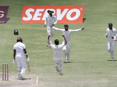 The Indian team celebrates a wicket. AP