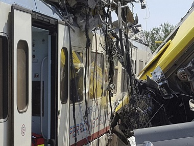 Crumpled wagon cars are seen after two commuter trains collided head-on near Andria, in Puglia.  Italian Firefighter Press Office via AP