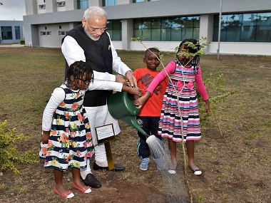 Prime Minister Narendra Modi planting a sapling of African mahogany at the Centre for Innovation & Technological Development at Maputo. PTI