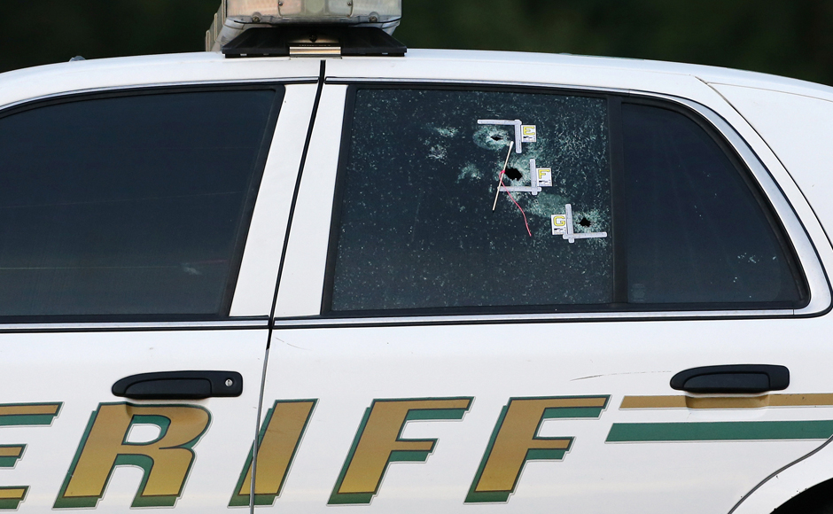 A bullet-ridden police vehicle seen in Baton Rouge, Louisiana near the scene where the police officers were shot. Authorities have opened up the area in Baton Rouge. Reuters