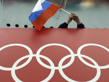 IOC decided against a blanket ban on Russia over doping charges. AP