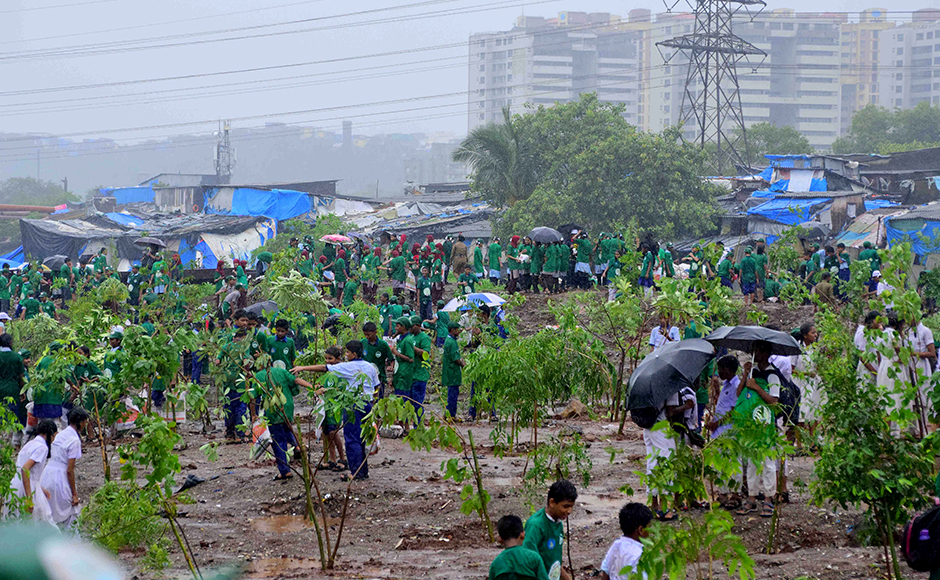 Students participate in a tree plantation drive at Maharashtra Nature Park, in Mumbai on Friday. (Sanket Shinde/ SOLARIS IMAGES)
