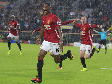Manchester United's  striker Marcus Rashford celebrates after scoring their late winning goal. AFP