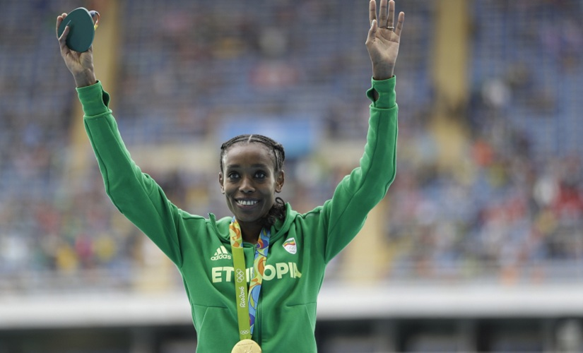 Ethiopia's Almaz Ayana celebrates winning the gold medal after the women's 10,000-meter final. AP