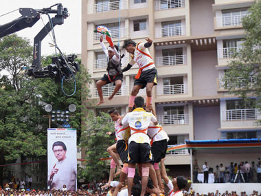 Govindas taking part in Dahi Handi celebrations by forming a pyramid on the occasion of Janamashtami in Thane, Mumbai on Thursday. The celebration was organised by MNS. PTI