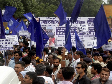 Ahmedabad: Members of Dalit Community protest in Ahmedabad on Tuesday against the assault on dalit members by cow protectors in Rajkot district, Gujarat. PTI Photo (PTI7_19_2016_000237B) *** Local Caption ***