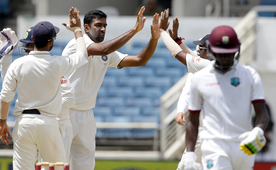 Indian spinner Ravichandran Ashwin celebrates the wicket of Jermaine Blackwood as he was taken aback by a brilliant catch by Cheteshwar Pujara. AP