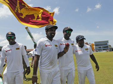 Vishwa Fernando, Dilruwan Perera, Angelo Mathews and Rangana Herath celebrate their victory over Australia. AP