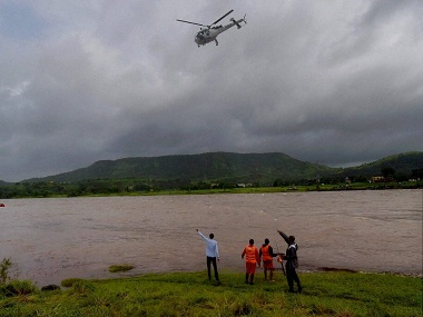 Mahad: Rescue work in progress near the collapsed Mahad-Poladpur bridge on the Mumbai-Goa highway, near Mahad in Raigad district on Thursday. PTI Photo by Santosh Hirlekar (PTI8_4_2016_000082B)