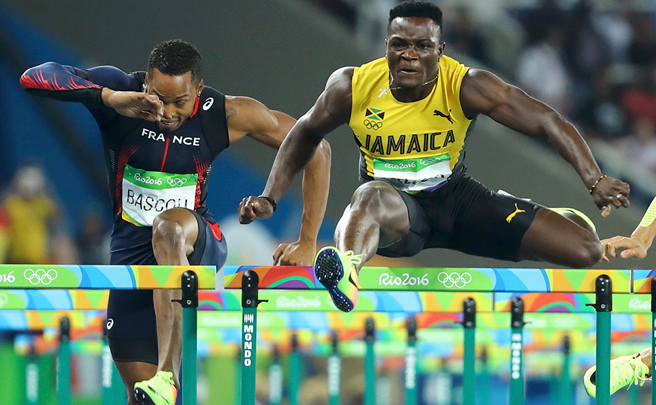 Omar McLeod of Jamaica crosses the finish line to win the gold, ahead of bronze medallist Dimitri Bascou of France in Men's 110m Hurdles Final at Rio Olympics. Reuters