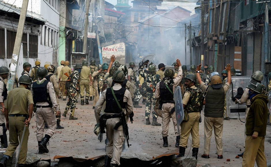 Security forces chasing away protesters during a clash in Srinagar on Monday. On 29 July, authorities had lifted curfew from entire Kashmir Valley except three police station areas after 51 days of continuous curfew. PTI