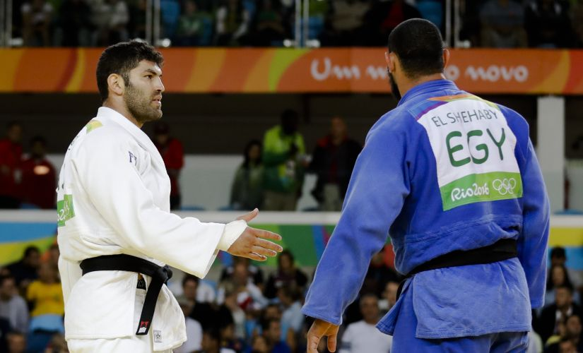 Egypt's Islam El Shehaby, declines to shake hands with Israel's Or Sasson, after losing during the men's over 100-kg judo competition. AP