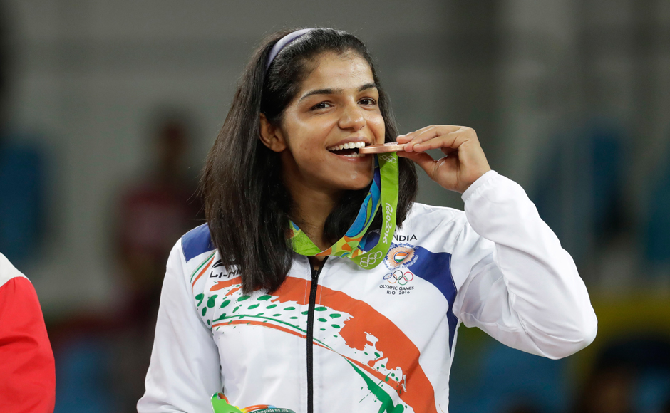 Sakshi Malik ended India's long wait for a medal at Rio Olympics after she won against Aisuluu Tynybekova of Kyrgyzstan in her women's freestyle 58kg bronze medal match. AP