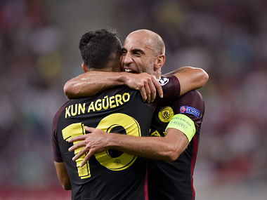 Manchester City's Sergio Aguero celebrates his goal against Steaua Bucharest, with Pablo Zabaleta during the Champions League qualifying playoffs. AP