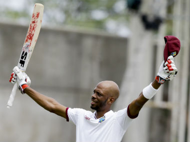 Roston Chase celebrates after reaching his maiden international hundred. AP