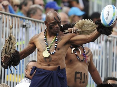 Fiji rugby fans cheer from the stands. Reuters
