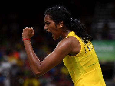 PV Sindhu celebrates winning a point in her badminton match at the Rio 2016 Olympics. Getty