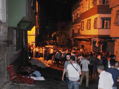 People gather after an explosion in Gaziantep, Turkey killed 51 of a wedding of a wedding party. AP