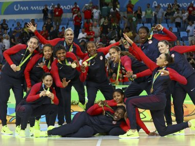 Team USA pose with their gold medals. Reuters