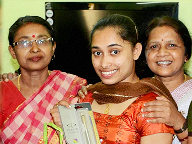 Dipa Karmakar, who finished a historic fourth in gymnastics at the just concluded Rio Olympics 2016, is welcomed at Tripura University in Agartala on Tuesday. PTI