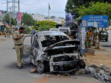 Several vehicleas bearing Tamil Nadu number plates were torche. Reutersd during the violence over Cauvery water sharing. Reuters