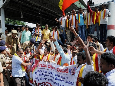 Bengaluru : Kannada activists stop the Tamil Nadu bound train during a protest against the Supreme Court verdict on release of Cauvery water for Tamil Nadu, in Bengaluru on Wednesday. PTI Photo (PTI9_7_2016_000157B)