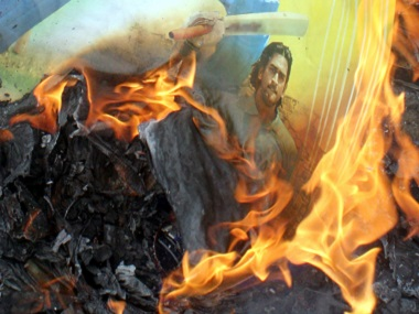 Cricket fans burn posters of Indian cricketers during a protest after the team's exit frm the 2007 World Cup. Reuters