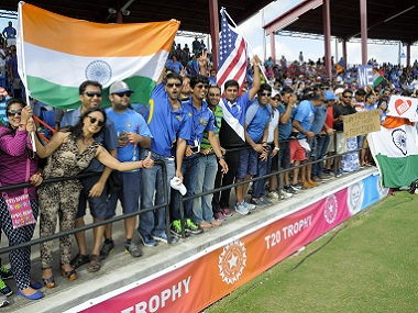 Indian cricket supporters cheer their team at the Fort Lauderdale Stadium in Florida. AFP