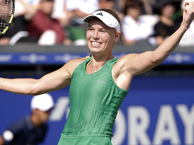 Caroline Wozniacki of Denmark celebrates after winning over Naomi Osaka of Japan during Pacific Open finals. AP