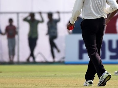 An umpire holds a pink ball during the Duleep Trophy.