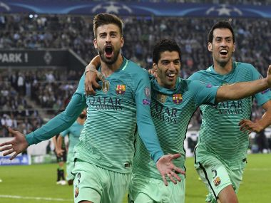 Barcelona's Gerard Pique celebrates his goal. AP