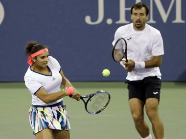 Sania Mirza and Ivan Dodig in action at the US Open. AP