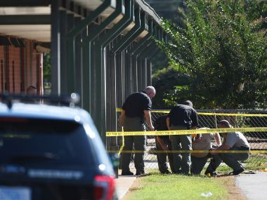 Members of law enforcement investigate an area at Townville Elementary School on Wednesday. AP