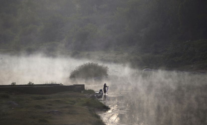 A woman by the banks of Cauvery. Reuters