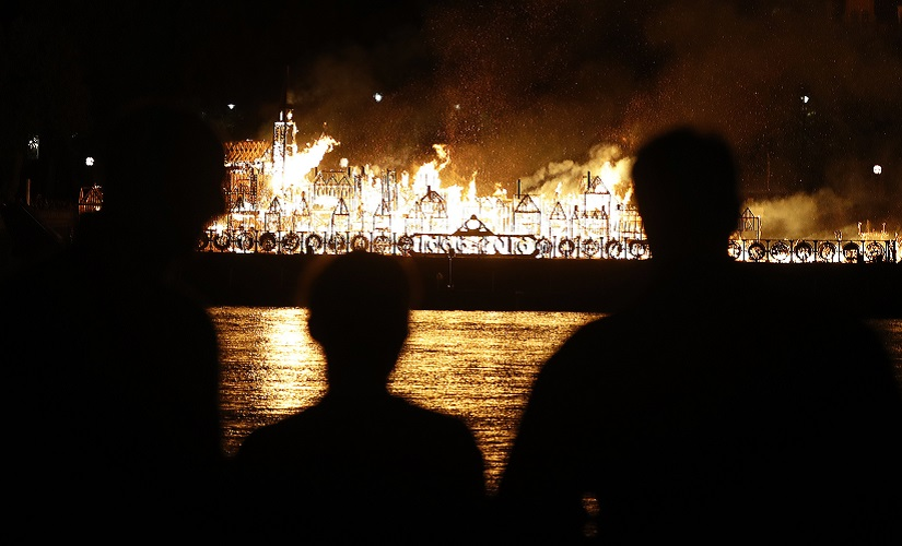 People watch as a 120-metre long sculpture of the 17th Century London skyline was set alight in a retelling of the story of the Great Fire of London in 1666. AP