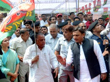 Uttar Pradesh Chief Minister Akhilesh Yadav with his SP supremo Mulayam Singh Yadav. PTI