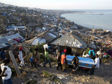 Residents carry a coffin containing the remains of a pregnant woman, a victim of Hurricane Matthew, in Jeremie, Haiti on Friday. AP