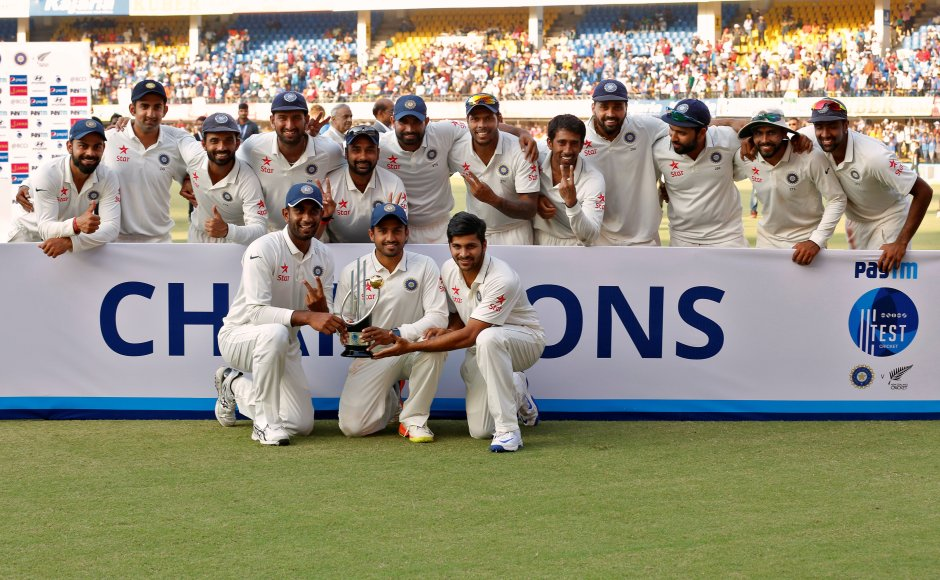 India mauled New Zealand by 321 runs in the third and final Test at the Holkar Cricket Stadium on Tuesday, completing a 3-0 clean sweep in the series. India's players pose with the trophy. Reuters