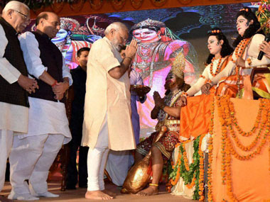 Prime Minister Narendra Modi performs aarti of artists enacting Lord Rama and Lakshman during Dussehra celebrations at Aishbagh Ram Leela in Lucknow. PTI