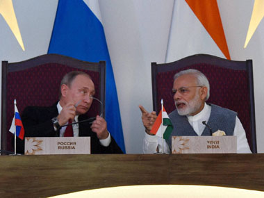 Prime Minister Narendra Modi with Russian President Vladimir Putin at the exchange of agreements ceremony after the 17th India-Russia annual summit meet in Benaulim, Goa on Saturday. PTI