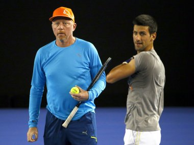 File photo of Serbia's Novak Djokovic (R) and his coach Boris Becker. Reuters