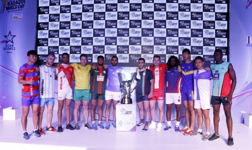 All the captains of the 12 teams with the 2016 Kabaddi World Cup trophy. PR