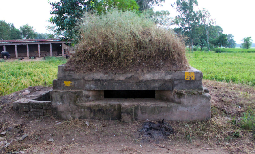 A bunker constructed in more tha 30 years ago in Abdullian by Indian army villagers use it during shelling cover them with sand bags.  Firstpost/Sameer Yasir