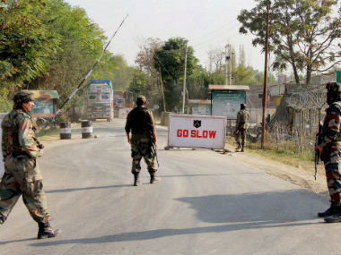 Soldiers guard at the Army base camp during the militant attack in Baramulla district. PTI