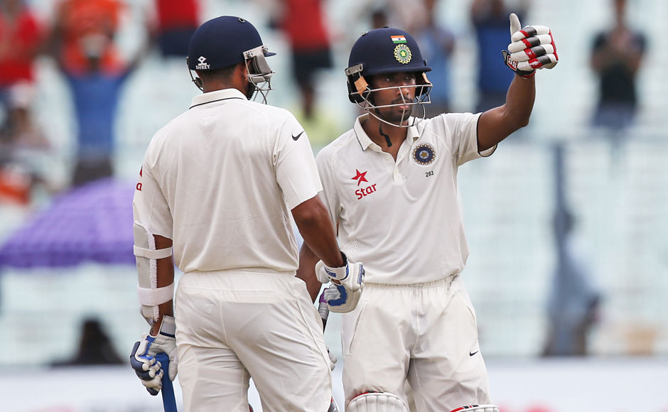 Wriddhiman Saha and Bhuvneshwar Kumar starred to help India gain control over New Zealand on day 2 of the second Test at the Eden Gardens. Saha scored a crucial 54* to take India past 300 after they were reeling at 231/7. AP