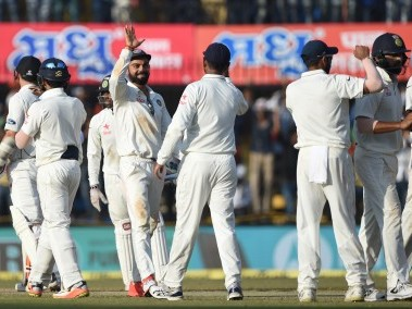 India's captain Virat Kohli with teammates after the New Zealand Test series. AFP