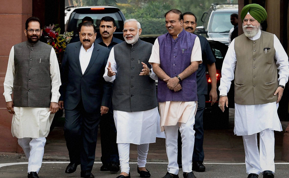 Prime Minister Narendra Modi, flanked by Parliamentary Affairs Minister Ananth Kumar and MoSes Mukhtar Abbas Naqvi, Jitendra Singh and SS Ahluwalia, arrives to address the media on the opening day of the winter session of Parliament in New Delhi on Wednesday. PTI