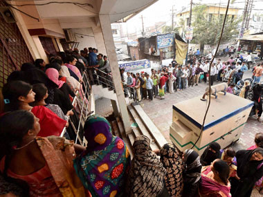 People queue up outside a bank to exchange their old Rs 1,000 and Rs 500 notes in Lucknow on  Saturday.  PTI