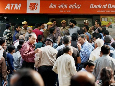 People scuffle to exchange Rs 500 and Rs 1,000 notes in New Delhi. PTI